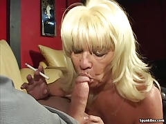 Huge-chested blonde gives..